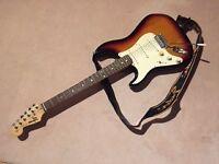 Fender Squier electric guitar and Peak amp