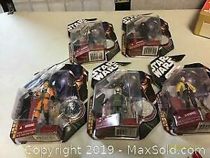 Lot of 5 Star Wars figures with coins