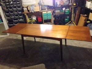 Mid-century Teak dining table and 6 matching chairs