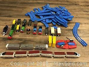 TOMY Plarail Train Set with Two Japanese Motorized Trains and Various Non-motorized Thomas Trains