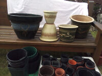 These are a selection ceramic pots and plastic pots