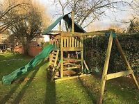 Children's wooden climbing frame with slide and two swings