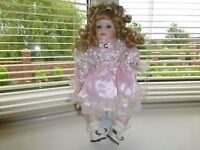 The Leonardo Collection hand painted porcelain doll