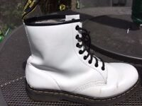 White lace up Doc Martins boots in white patent, in excellent condition