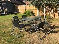 Garden / Patio Table and 6 folding chairs - good condition.