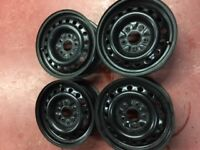 Four (4) 16 inch Steel Rims - one season use -  new condition