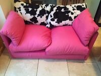 Pink sofa that folds out into double bed