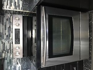 Samsung electric stoves with oven range and ceramic top.