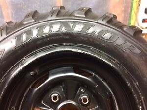 Set of four ATV tires and rims.