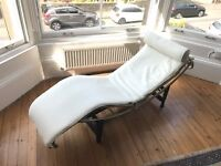 """Quality reproduction """"Le Corbusier"""" white leather recliner."""