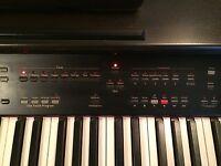 Digital Roland KR-177 piano