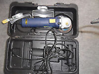 angle grinder 4/ 1/2 inch in carry case with spare discs and instructions used once