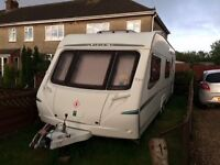 Caravan For Sale. Six berth touring caravan, including full and half awnings