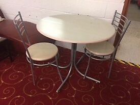 Round table & 2 chairs at Cambridge Re-Use (reuse)