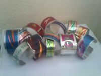 set of hand made painted metal bracelets different sizes
