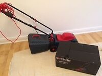 Sovereign electric lawnmower with collector box. Hardly used!