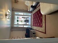 Spacious 4 bedroom mid terraced house with conservatory for rent