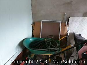Wheelbarrow, Garden Hose and Trash Cans C