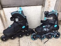New pair of inline skates, black/ blue, size 4