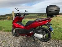 Honda PCX 125, 1 owner from new, main dealer service history, Givi top box and heated grips