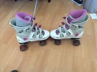 4 wheel roller skates, good condition, one buckle is broke but still fasten up strong and work great