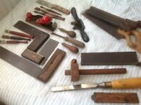 Collection of vintage woodworking tools, chisels, plane, saws, setsquares and many other items
