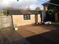 Take down garage and shed, make ground level then put up new garage with existing garage door