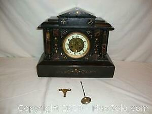 Antique French solid marble mental clock.