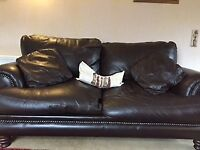 Majestic African leather couch with refined studs and crafted wooden legs COLLECTION ONLY
