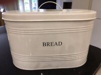 Cream enamel oval bread bin. Good condition.