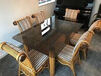 Beautiful Smoked glass dining Table and Six Chairs, cost over £2500 when new