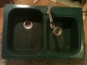 Swanstone teal-green double kitchen sink with pull-out faucet.