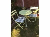 Sturdy steel bistro set with cushions, folding chairs.NEW