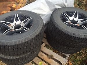 For sale:275/65/17 studded winter tires and rims.