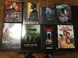 LARGE ASSORTMENT of DVDs, VHSs and SKING BOOKS