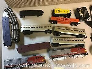 lot of Lionel and Marx train sante fe cars engine and other