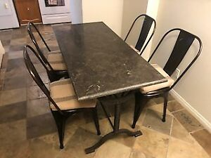STONE TABLE AND INDUSTRIAL CHAIRS
