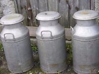 3 vintage aluminium milk churns in very good condition with farm name engraved for sale