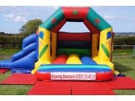 Children's bouncy castle with slide