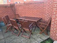 6-seater wooden table and chairs