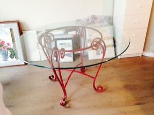 Heavy plate glass bevelled round table and wrought iron base