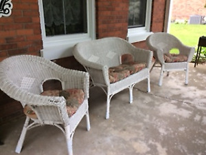 Wicker loveseat and two chairs