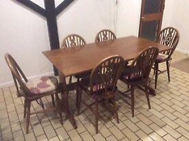 Oak Veneer Table, 6 Wheel Back Chairs and Dresser