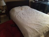 Beautiful leather wrapped Queen sizedbed frame asking 175.00 OBO