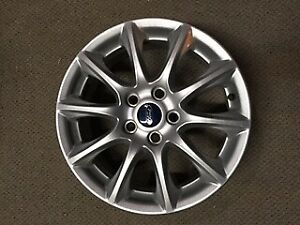 Ford Fusion factory wheels 16 inch for sale.