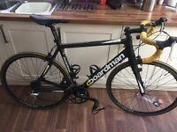 C Boardman carbon fibre road bike