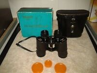 Binoculars Swift Technar ZCF 8x40, No45663 341ft at 1,000yds with lens caps and leather case.