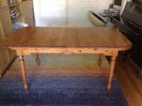 Extending pine table.
