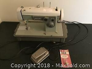 Sears Kenmore Sewing Machine with portable case.