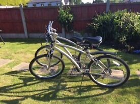 A PAIR OF SUPERB LANDRIDER BIKES WITH AUTO SHIFT GEAR CHANGE